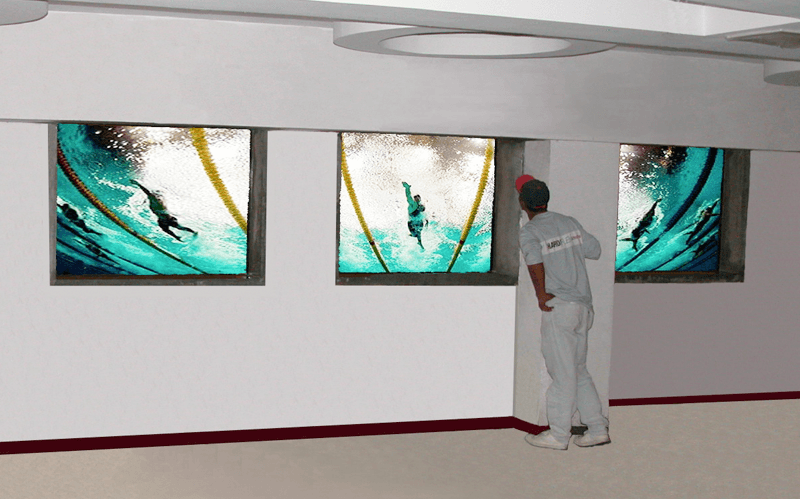 underwater windows with view of swimming competition